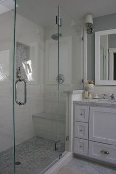 Seamless shower stall, white tile, subway tile, gray walls, marble counters...
