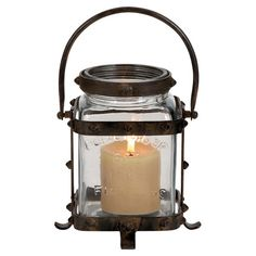 Illuminate your mantel or bring rustic charm to your dining table centerpiece with this vintage-inspired glass lantern, showcasing riveted metal details and ...