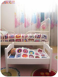 Cute, matching blanket for doll's bed. But I'm really loving the girl's bed!!
