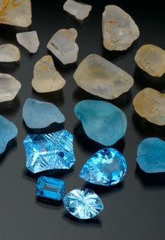 BLUE TOPAZ - Virtually colorless topaz rough (above) is irradiated and then heated to turn blue (middle layer of rough)
