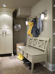 Mud room -ikea wardrobes trimmed in w/ crown moulding