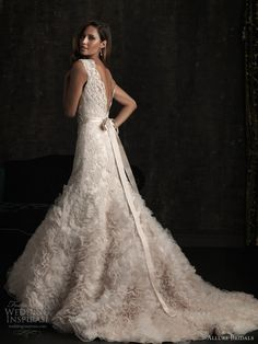 Sleeveless lace and tulle ruffle gown with satin belt and v-back. Allure.