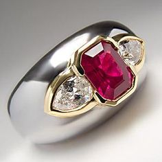 Bulgari Ring- platinum wide band with Burmese ruby and two pear shaped diamonds in bezel mounting of 18k yellow gold