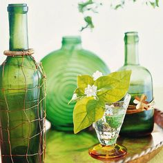 Gather a collection of green glass vessels for an easy centerpiece.