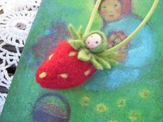 I love this little strawberry doll necklace for a little girl
