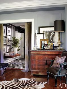 Note the contrast: stripe below crown moulding - brings ceiling height down but striking. Additional moulding on walls (same color) adds depth. Grey brings out wood tones of dresser.