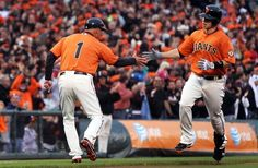 San Francisco Giants third base coach Tim Flannery congratulates Buster Posey on his two run home run against the Houston Astros during the first inning of their MLB baseball game in San Francisco Calif., Friday, July 13, 2012.#Repin By:Pinterest++ for iPad#