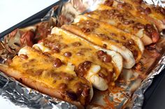 Oven Hot Dogs - YUM!  I used turkey chili with no beans, whitewheat buns, 97% fat free hot dogs and reduced fat shredded cheese. I didn't use any of the other ingredients (they don't seem necessary with the chili/cheese)   It was fairly healthy and REALLY good!~Leilani