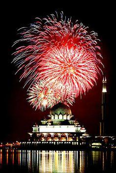 Fireworks explode over Malaysia's landmark, Putra Mosque, in Putrajaya