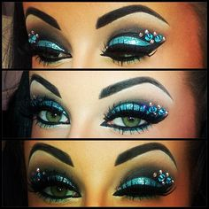 Sparkly turquoise eye shadow with a rhinestone accented black winged liner.