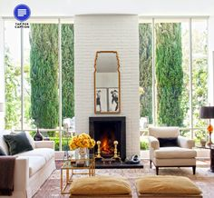 Amazing windows and fireplace! Jeff Klein and John Goldwyn's LA home, as seen in Architectural Digest, March 2014