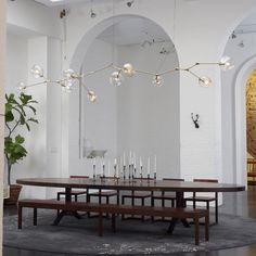 Custom Lindsey Adelman fixture. BBDW Dining table and chairs. Looks like the BBDW showroom in NYC. Obsessed.