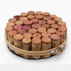 Make a trivet out of wine corks and an embroidery hoop.
