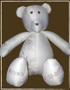 @patchworkbear Keep the memory of your wedding day out on display as a Keepsake Wedding Dress Bear! Your wedding dress will be transformed into a beautiful patchwork bear. Your favorite dress details will be incorporated into the bear and accented with hand-stitched eyes and nose in a complementary light silver gray color.