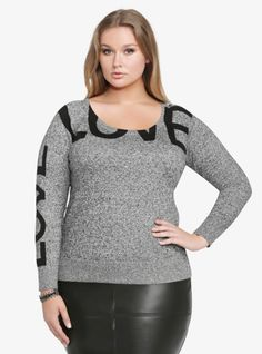 """Soft and so close to cashmere, this black and white marled pullover has the word """"love"""" written in black across the chest and down the long raglan sleeves. With a relaxed scoop neck, the sweatshirt-inspired style has a banded, ribbed bottom hem that adds a fitted shape to the sexy silhouette."""
