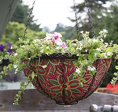 very cool decorative hanging baskets from madaboutgardening.com