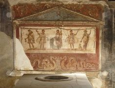 Ancient painted wall frescoes at the ancient Roman city of Pompeii