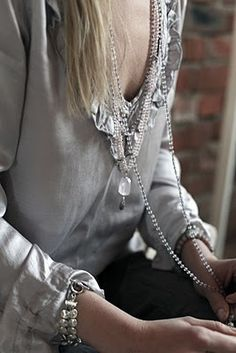 silky blouse and long necklace