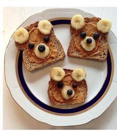 """Breakfast Bears, made from whole wheat toast, peanut or almond butter, bananas, blueberries and a little honey (optional). When served with a side of """"porridge"""" (oatmeal & applesauce) you'll  have a storybook breakfast sure to delight any diner. (Note: Link to website no longer has pin.)"""
