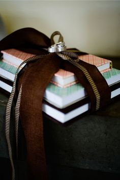 books tied with ribbon, ring pillow alternatives