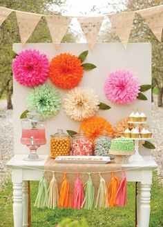 Beautiful bright dessert table with tissue paper flowers