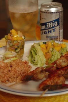 Cinco de Mayo Menu.  Mexican rice, Grilled shrimp with Mango salsa, Ensalada and Ice Cold San Mig Beer (Best beer in the world)