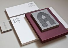 Andfold Studio's stationery system with luscious duplexing, embossing and foil stamping. Yum!