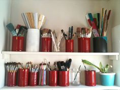 sorting paintbrushes & art tools in spraypainted recycled tin cans!  from Artful Mayhem Studio