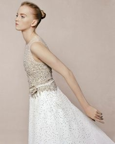 """Crystal and Tulle Wedding Dress"""" A crystal-dipped bodice gives the tulle """"Leila"""" gown a retro flair; belt, Monique Lhuillier. c/o marthastewartweddings For Planning Help Call (410)819-0046   MaryannJudy.com"""