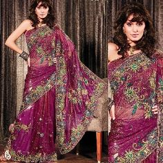 Designer Net Embroidered Saree -- Flaunt your feminine grace and charm dressed in this gorgeous purple and green shade net saree. The lovely designs adorning the body, border and pallu is embellished with gota, beads, stones, zircon, sequins and resham work. It is paired with a matching blouse. A fusion of color & design will definitely add wings to you. Our sarees in this wedding collection are very delicately hand embroidered with the finest quality of crystals and zircons. $339