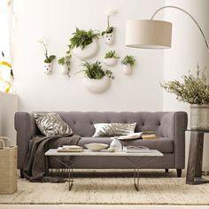 gray tufted sofa and arched lamp