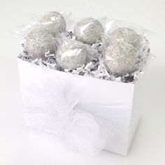 Wedding cake pops from Candy's Cake Pops in this white basket box with sparkle tulle from Nashville Wraps.