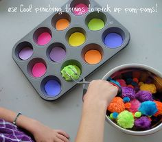pom pom color sorting...olivia does this and loves it! she uses my kitchen tongs to make it more fun.