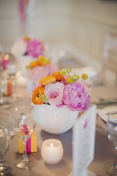 A mix of round and rectangular tables at bright and colorful pink, orange, yellow and gray weddding at Burlington Golf and Country Club | Planning and Design by www.kjandco.ca | Photography by Elizabeth In Love  Read more - http://www.stylemepretty.com/2013/09/04/burlington-ontario-wedding-from-kj-co-beth-ty-in-love/