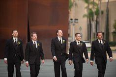 groom and groomsmen in black suits.