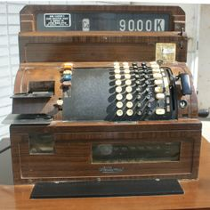 Vintage cash register. I used to have one of these. This might make playing shop with the bubs actually fun.