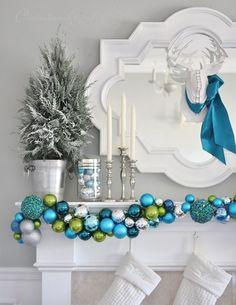 So pretty!! ornament garland on mantel
