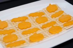 Halloween cheese and crackers: I like the idea of using mini cookie cutters for cheese display