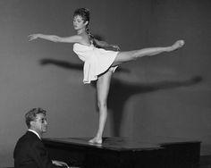 Brigitte Bardot on a piano