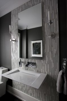 Great tile, sconces, sink and wall color