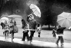 St. Margaret Mary students shield themselves from drizzle as they walk home along Dodge Street on March 11, 1974. Omaha only had rain as it dodged a winter storm that dumped a foot of snow on the Nebraska Panhandle. THE WORLD-HERALD