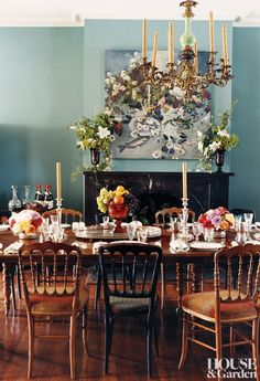 The dining room of a New Orleans home feels like a lush, romantic garden, with a flora-inspired chandelier. #houseandgarden