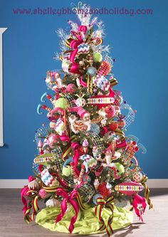 Christmas tree decorated in fun candy colors  visit this site for more decorated tree ideas!