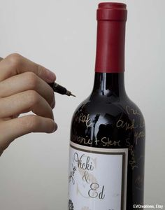 Set out 5 wine bottles for guests to sign and save the bottles to drink on your 1st, 5th, 10th, 15th and 20th wedding anniversaries!  I love this idea!