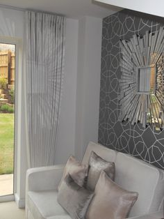 Floor to ceiling curtain, the detailed wall and mirror!