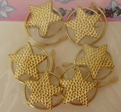 Match that golden dress with hair accessories. Hair Spins in Sparkling Tiny Gold Tone Stars by hairswirls1, $9.99