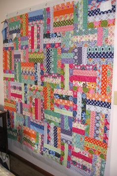 Love the fabrics, and the mismatched blocks, no pattern, but can be figured out.