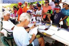 Participants of the 39th annual Boys and Girls Surf Fishing Tournament Saturday, Aug. 9 wait for Darlene Keuerleber and Margaret Feil, both with the Ocean City Fishing Club, to review the score sheets and name the winners of the tournament, which was held at the beach near the Ocean City-Longport Bridge and is co-sponsored by the fishing club and the Ocean City Department of Recreation.