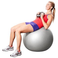 Work your abs with a weighted crunch on the stability ball.