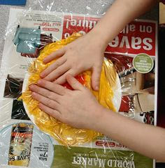 Weather Wonders Theme: Great weather related preschool craft projects.  Pictured project involves squishing paint under saran wrap to form craft model suns.